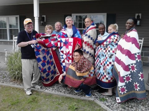 The vets showing off their Quilts of Valor.  BRILLIANT.